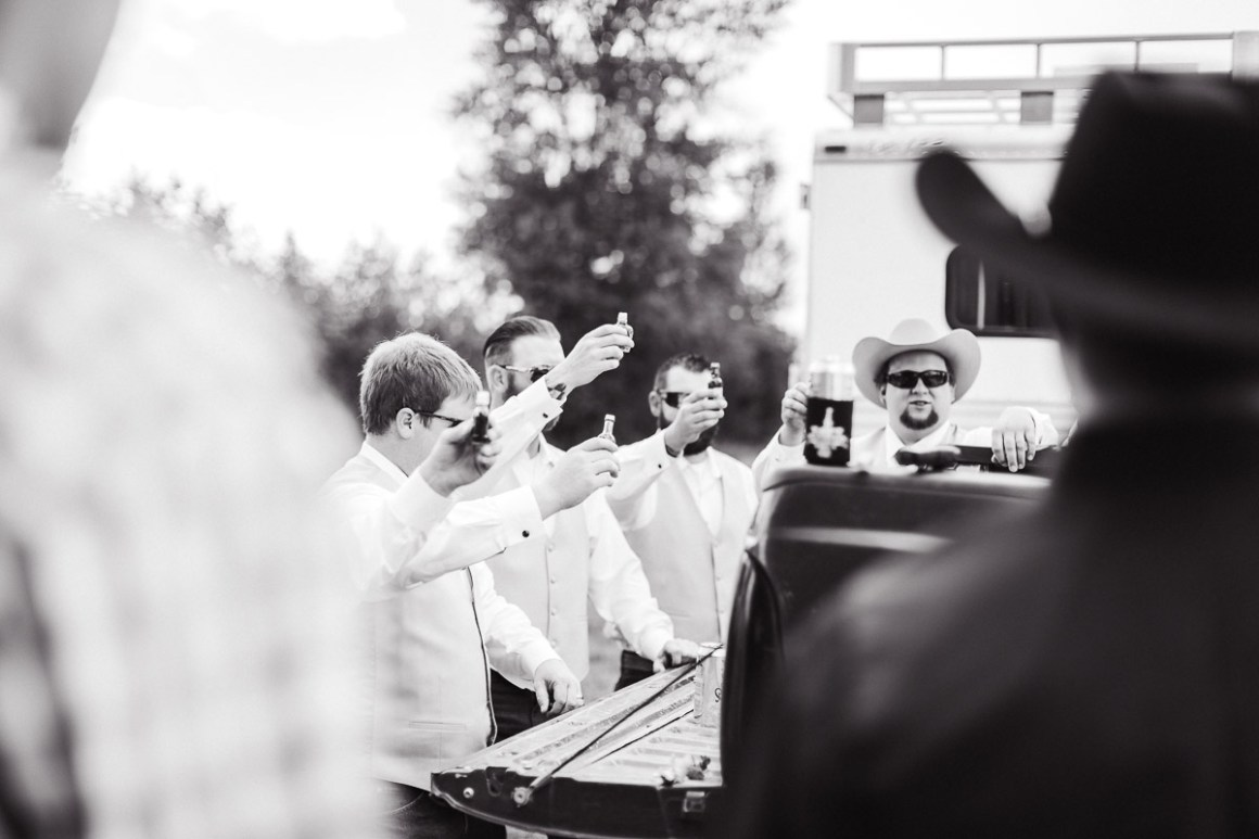 The groom and his groomsmen prepping the best way they know how.....