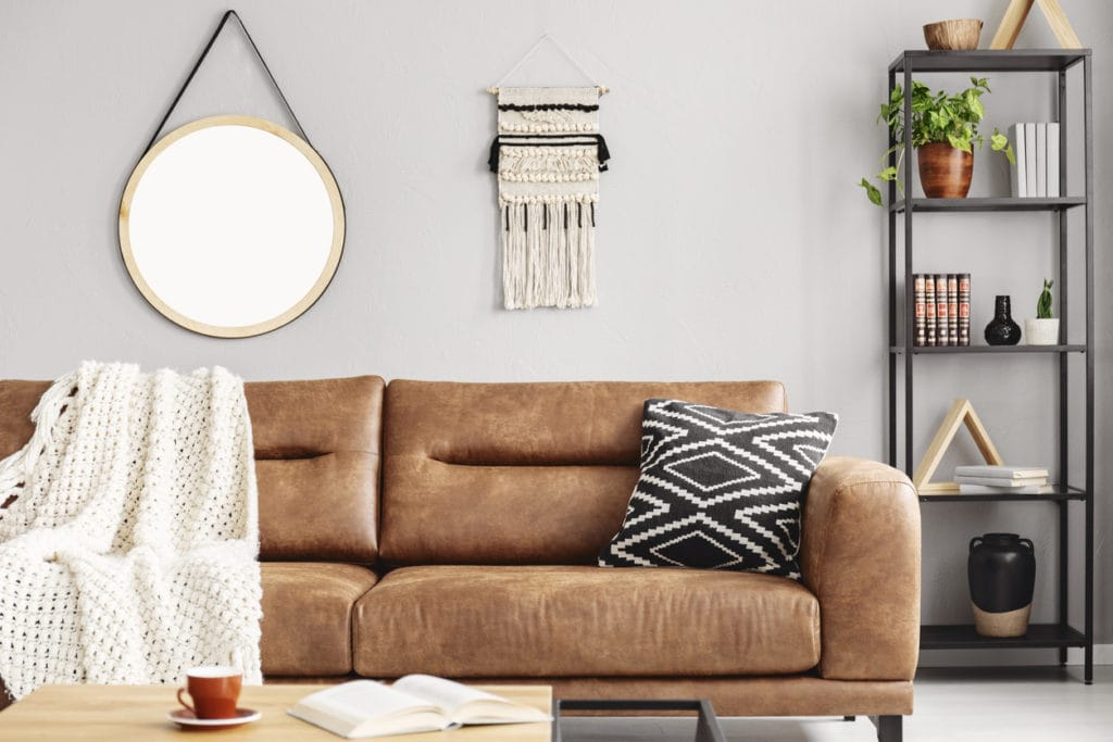 are brown leather couches in or out