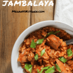 Bowl of jambalaya with a fork in it.