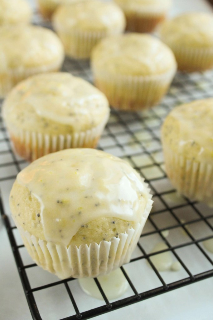 Extra Lemony Poppy Seed Muffins on a cooling rack.