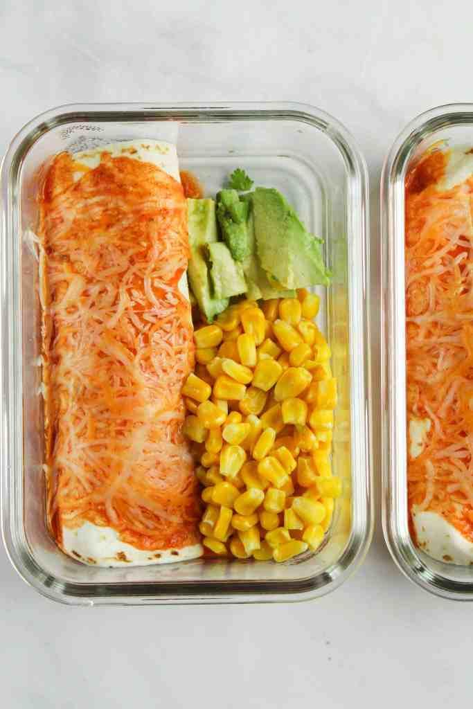Meal Prep Enchiladas with corn and avocado.