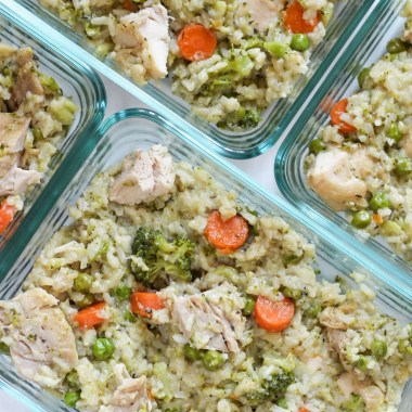Chicken and Rice- Half cauliflower rice, half long-grain rice.. In a meal prep container.
