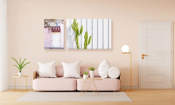 Two canvas prints on a wall over a sofa.