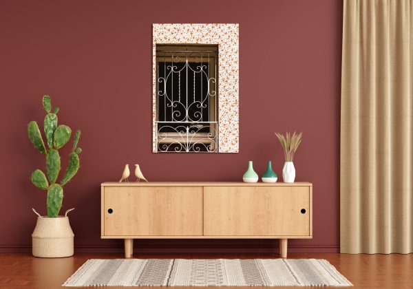 A canvas print of a tiled doorway over a shelf.