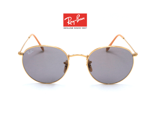 This iconic Ray Ban in gold frame and pink lens screams female power.