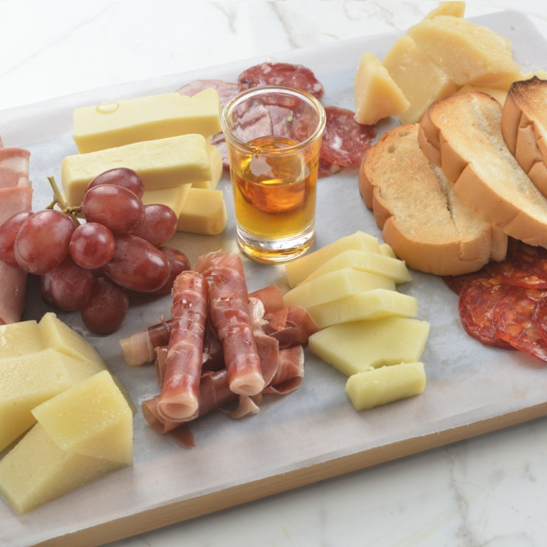 If you're going light, order the Formaggi Misti (P700), which is a charcuterie of premium cheeses. The board contains a traditional variety of Italian Cheeses, which is already good for two people! Perfect for date nights at home.