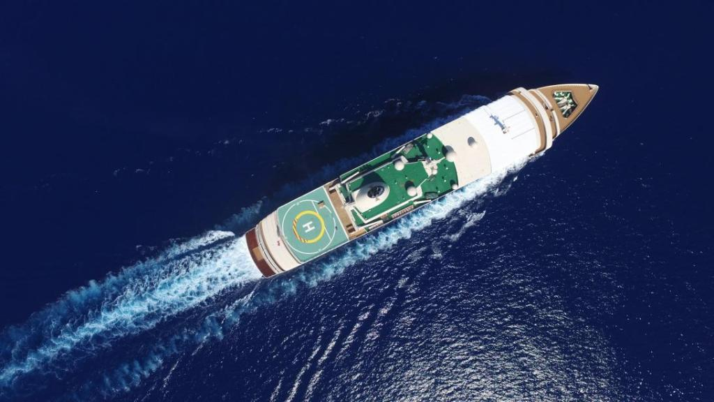 picture large super yacht above from helicopter with helipad helicopter landing on super yacht