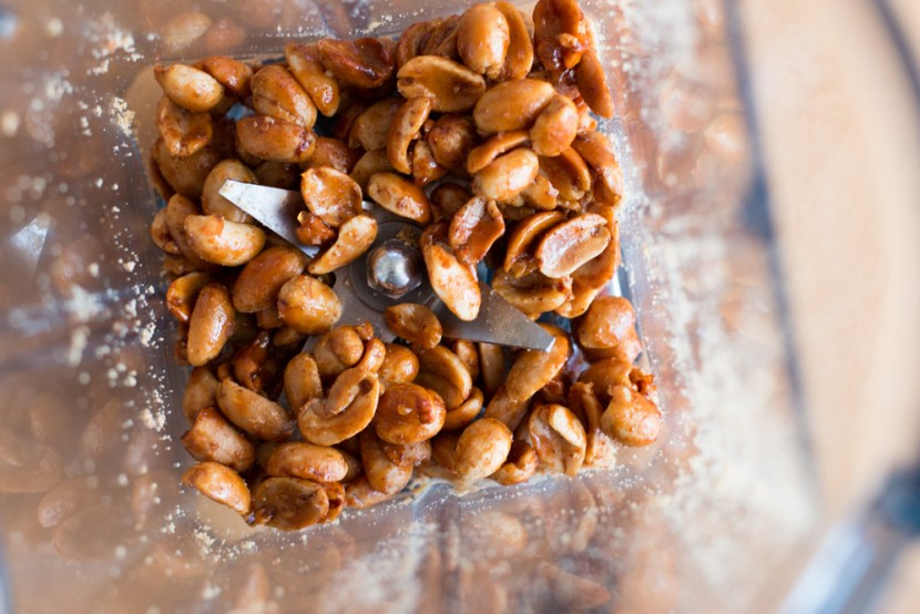 Place a handful of nuts in the Vitamix, making sure you can see the tops of the blades.