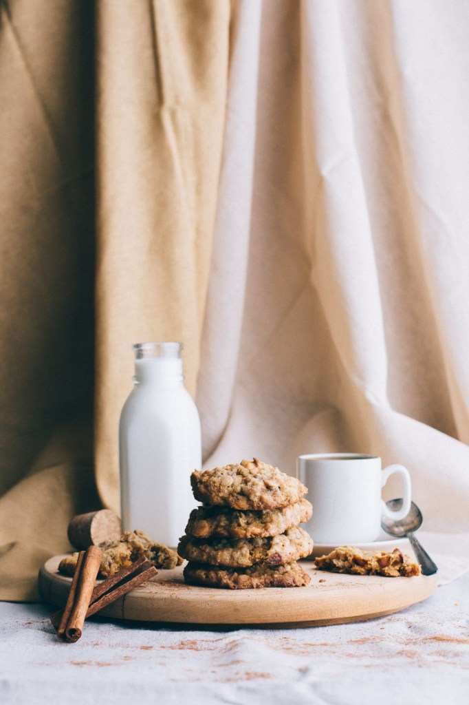 Oatmeal Scotchies get a sweet and spicy twist by using maple syrup instead of sugar, crisp bacon, and crystalized ginger nibs. Oatmeal and butterscotch never tasted so good! | www.megiswell.com
