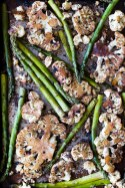 Oven Roasted Cauliflower Steaks with Black Garlic and Asparagus is a very simple and quick one-sheet meal that has a ton of flavor thanks to the umami of black garlic. | www.megiswell.com