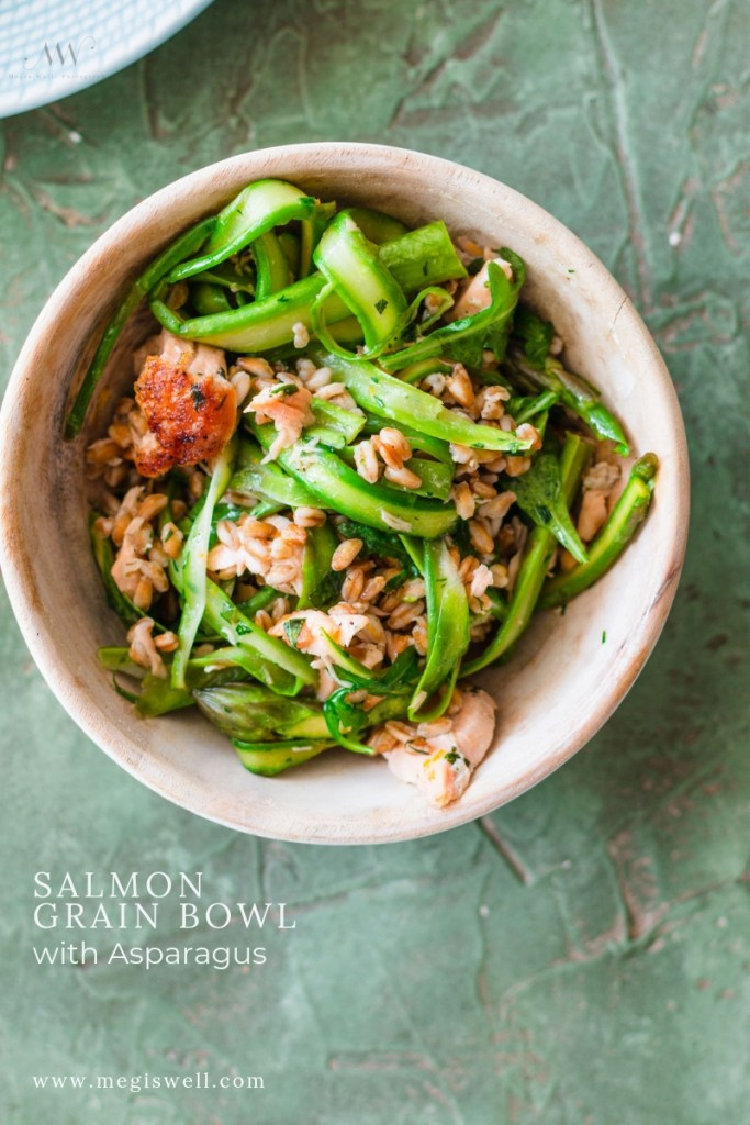 This Salmon Grain Bowl with Asparagus is high in protein and is filled with fresh herbs and citrus notes that make it a perfect spring recipe! | #salmonbowl #proteinbowl #healthydinner #megiswell #meganwellsphotography | www.megiswell.com