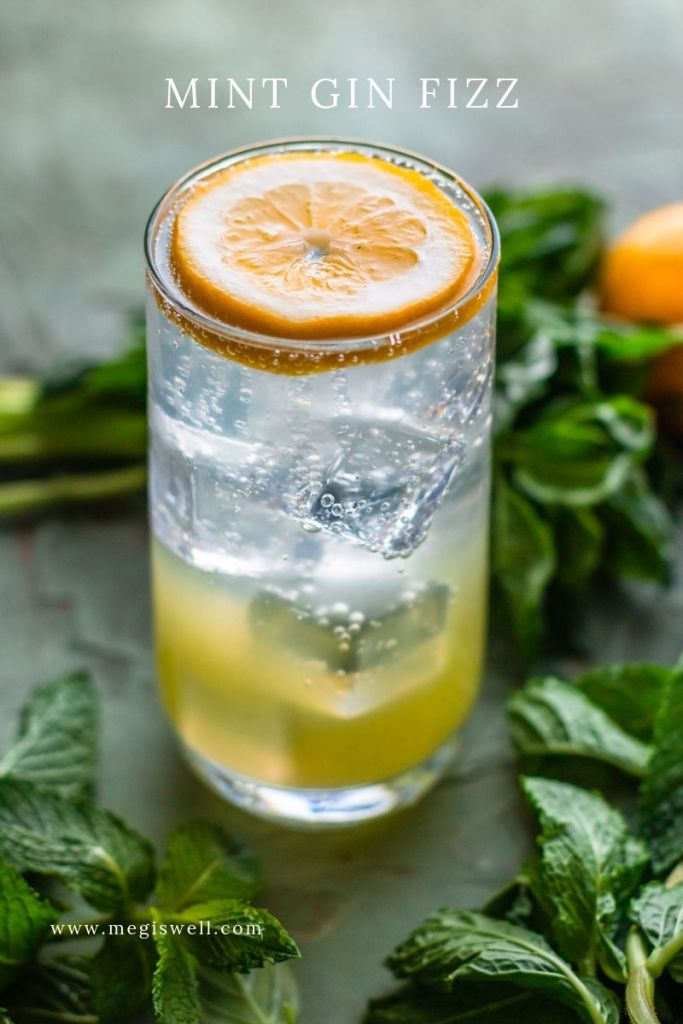 This Mint Gin Fizz gets it aromatic zing from muddled mint and a Lemon Shrub with Cardamom and Mint. It's refreshing, fizzy, and cooling, perfect for hot spring or summer days! | Gin Bar | DIY | Cocktail Recipe | #ginfizz #shrubcocktail #megiswell #meganwellsphotography | www.megiswell.com