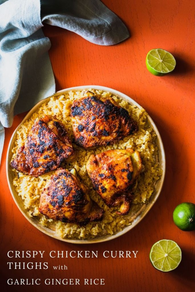 Crispy Curry Chicken Thighs with Garlic Ginger Rice is fragrant and delicious comfort food. The chicken is crisp yet juicy and the rice is good enough to eat on its own. | Thai Yellow Curry Paste | Main Dish | #chickendinner | www.megiswell.com