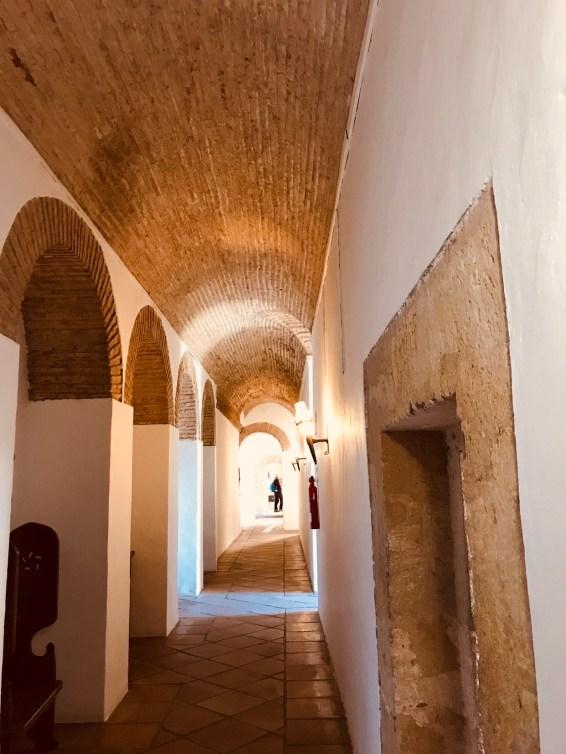 The arched hallway inside the Alcazar.
