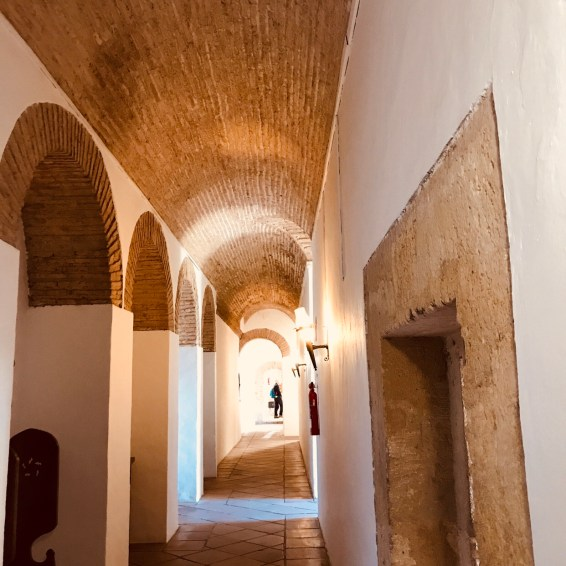 The arched hallway inside the Alcazar.