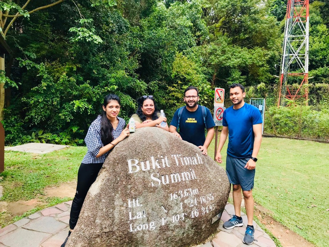At the highest hill in Singapore- summit of Bukit Timah trail.