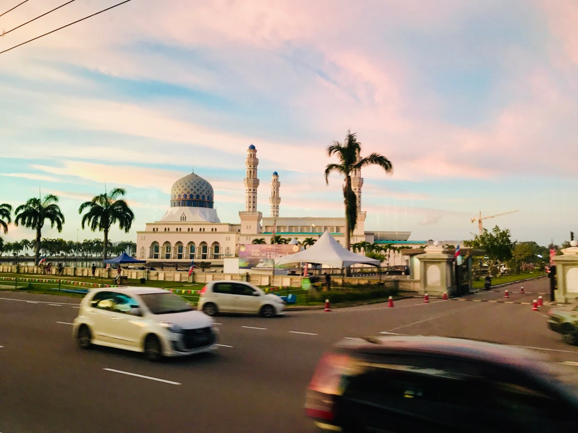 Sunset drive through voew of the city Mosque at kota kinabalu