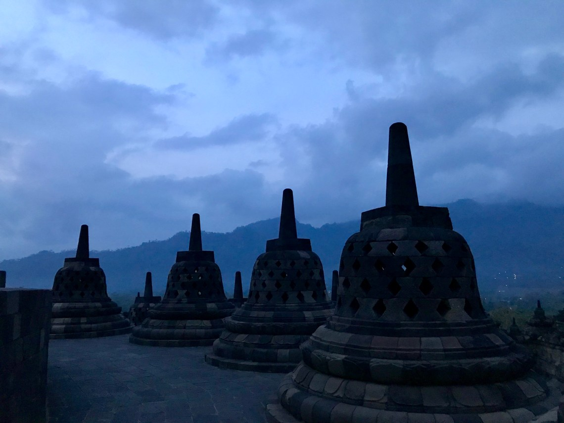 The wonderful stupas at dawn at Borobudur Temple.