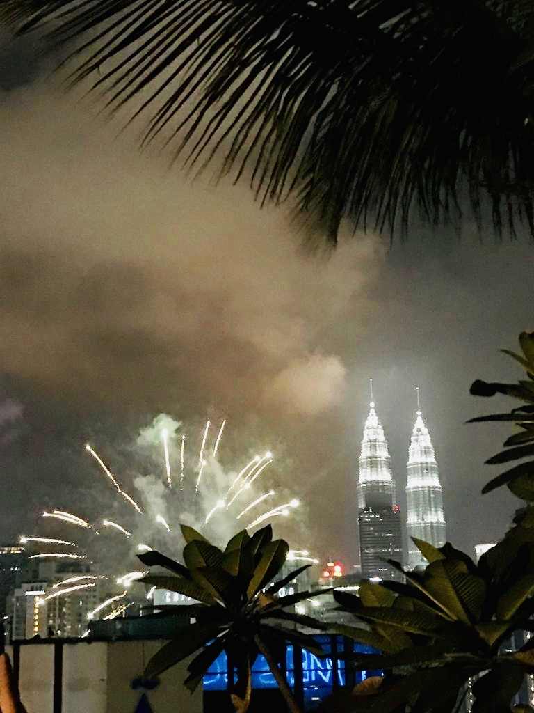 Spectaular view of the fireworks and the twin towers from the rooftop of our Hotel in KL.