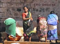 Ladies washing clothes and dishes in town, Gokarna