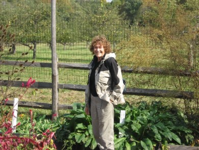 M.P. standing in the herb garden in Jockey Hollow.