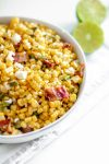 This Grilled Corn Salad with Bacon and Jalapeno is your next potluck dish. Sweet grilled corn, smoky bacon, spicy jalapeno and a bright lime dressing.