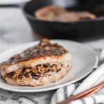 We're getting a little fancy here today but no worries, as always the recipe involves just a handful of easy to find ingredients. These Stuffed Pork Chops with Wild Rice are easy enough for a weeknights but dressed up enough for guests.