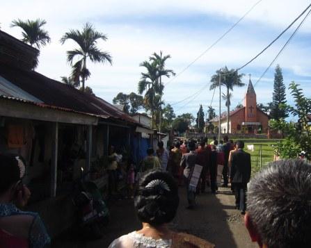 Wedding procession to the church. Sidamanik village, 22 August 2012.