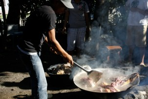 Boiling the meat.