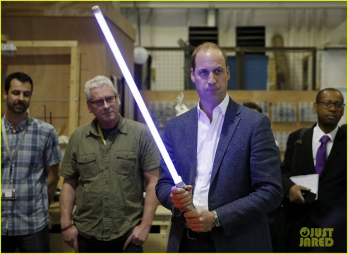 IVER HEATH, ENGLAND - APRIL 19: Prince William, Duke of Cambridge holds a lightsaber during a tour of the Star Wars sets at Pinewood studios on April 19, 2016 in Iver Heath, England. Prince William and Prince Harry are touring Pinewood studios to visit the production workshops and meet the creative teams working behind the scenes on the Star Wars films. (Photo by Adrian Dennis-WPA Pool/Getty IMages)