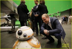 IVER HEATH, ENGLAND - APRIL 19: Prince William, Duke of Cambridge smiles at the BB-8 droid during a tour of the Star Wars sets at Pinewood studios on April 19, 2016 in Iver Heath, England. Prince William and Prince Harry are touring Pinewood studios to visit the production workshops and meet the creative teams working behind the scenes on the Star Wars films. (Photo by Adrian Dennis-WPA Pool/Getty IMages)