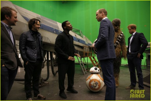 IVER HEATH, ENGLAND - APRIL 19: Prince William, Duke of Cambridge speaks with British actor John Boyega (C) and Episode VIII director Rian Johnson (2nd L) during a tour of the Star Wars sets at Pinewood studios on April 19, 2016 in Iver Heath, England. Prince William and Prince Harry are touring Pinewood studios to visit the production workshops and meet the creative teams working behind the scenes on the Star Wars films. (Photo by Adrian Dennis-WPA Pool/Getty IMages)