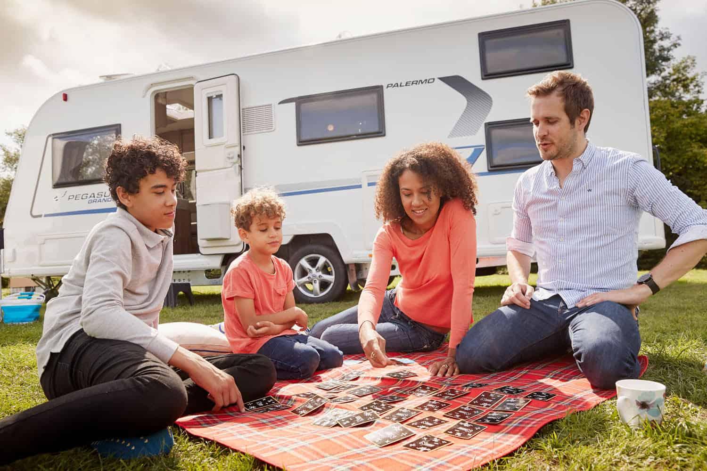 Family outside caravan