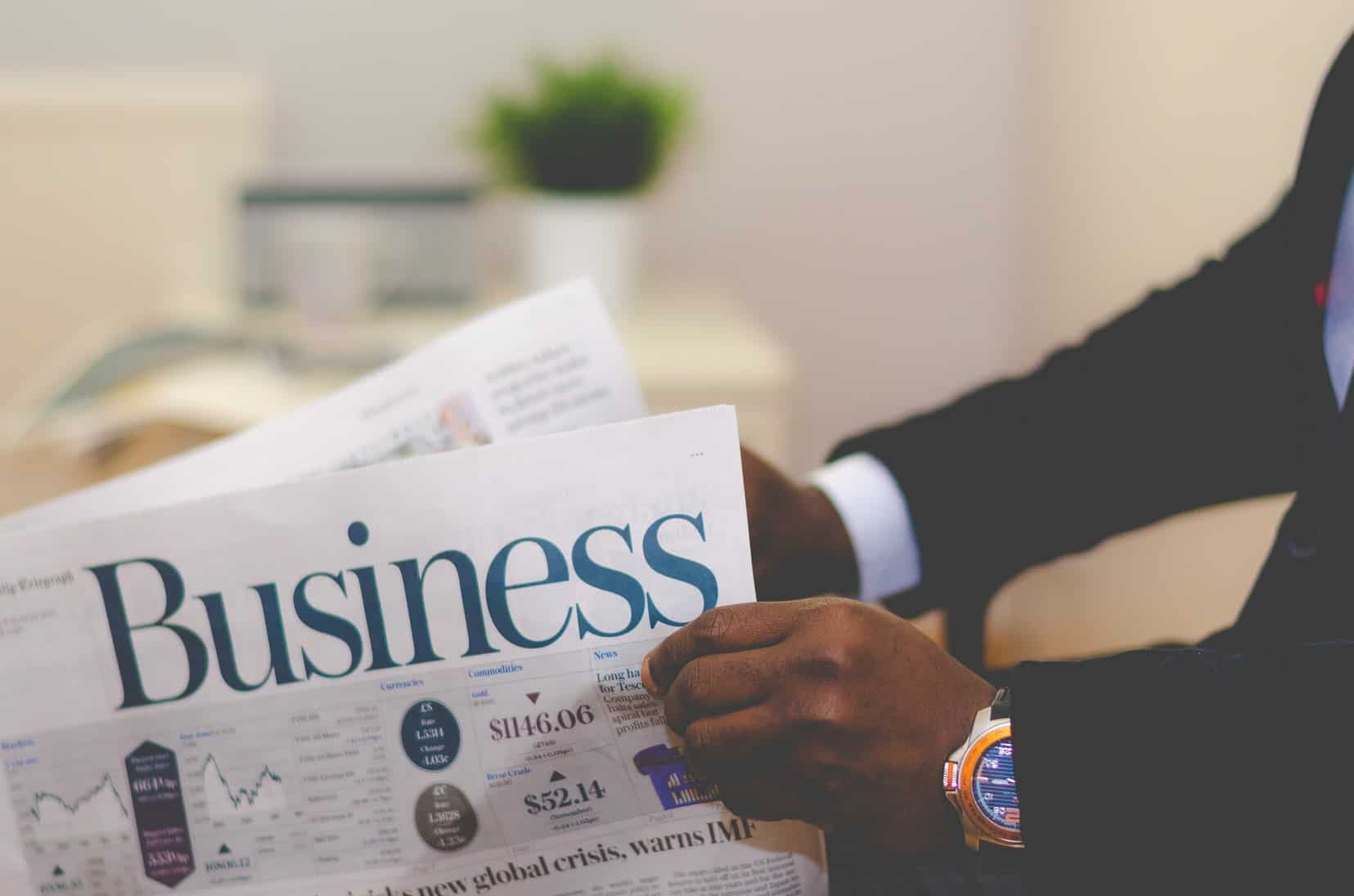 Person reading a Business paper