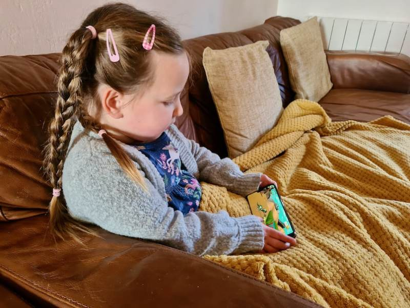 Erin playing on a phone