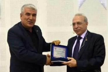 Mehmet Koruk'a plaket verildi!