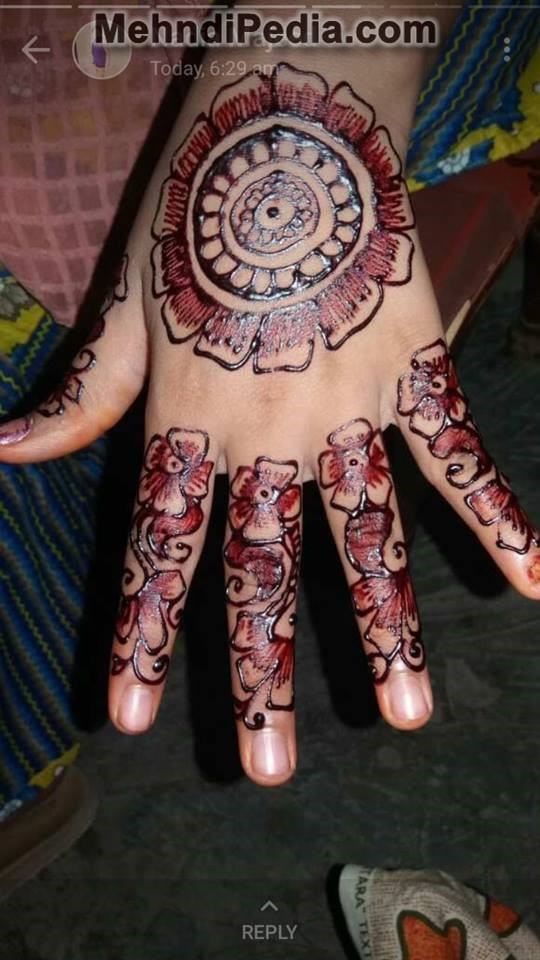tiki on back hand mehndi designs