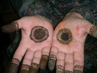 front hand circle and finger mehndi designs