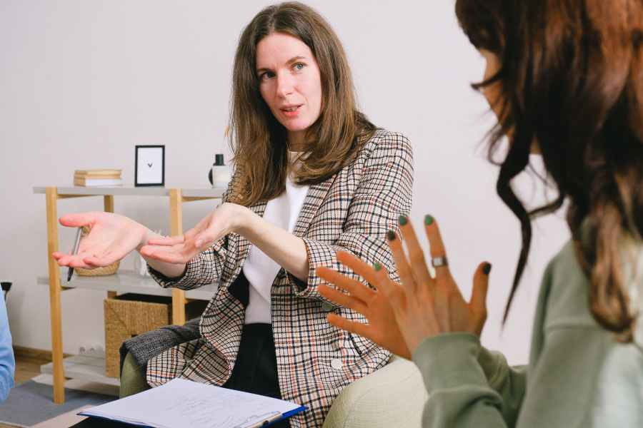 woman explaining detail of project to colleague