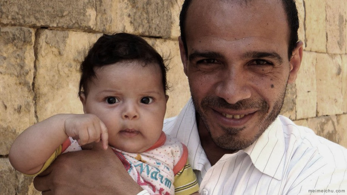 The proud Egyptian father showing off his baby to the world