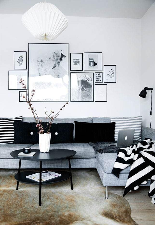 This gallery wall has started with a straight line at the bottom and then worked upwards Credit: alt.dk