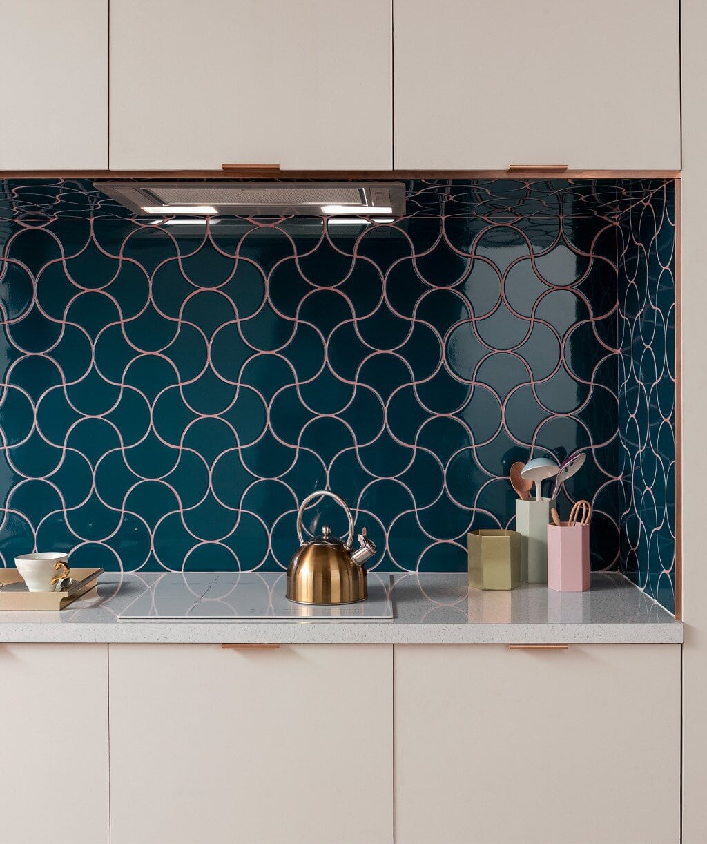 Syren tile with pink grouting in the kitchen. Credit: Topps Tiles