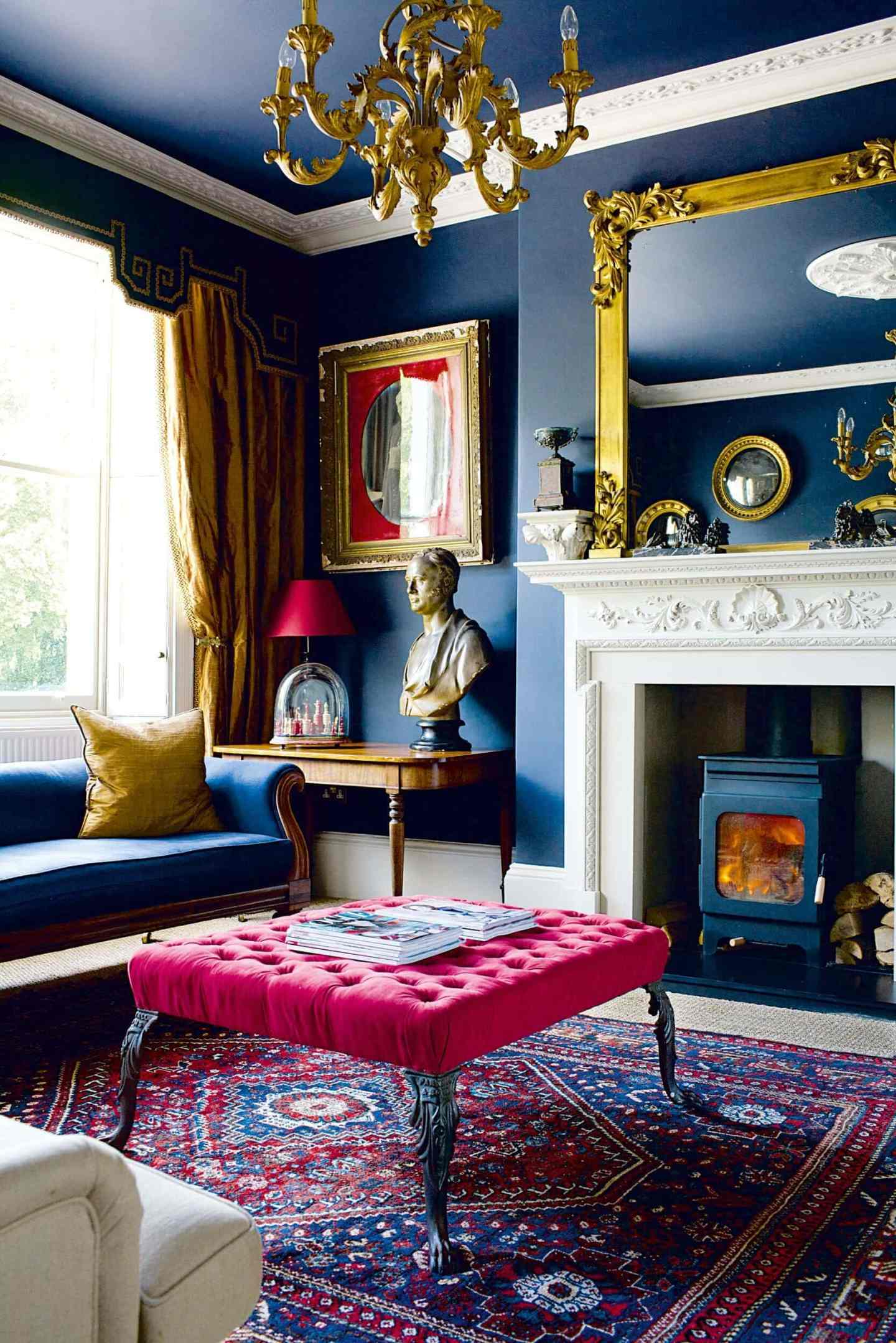 A room that has it all, dark inky walls and ceilings to match, detailed cornices and ceiling rose with gold details to bring the room beautifully together.  www.realhomes.co.uk  Image Credit: Grant Scott