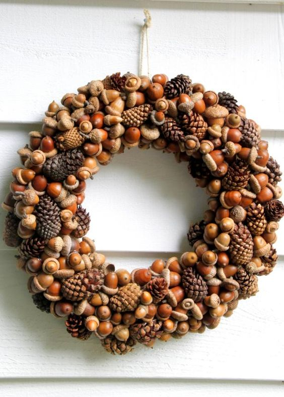 Try an all acorn and pine cone wreath, simple but effective - www.hgtv.com