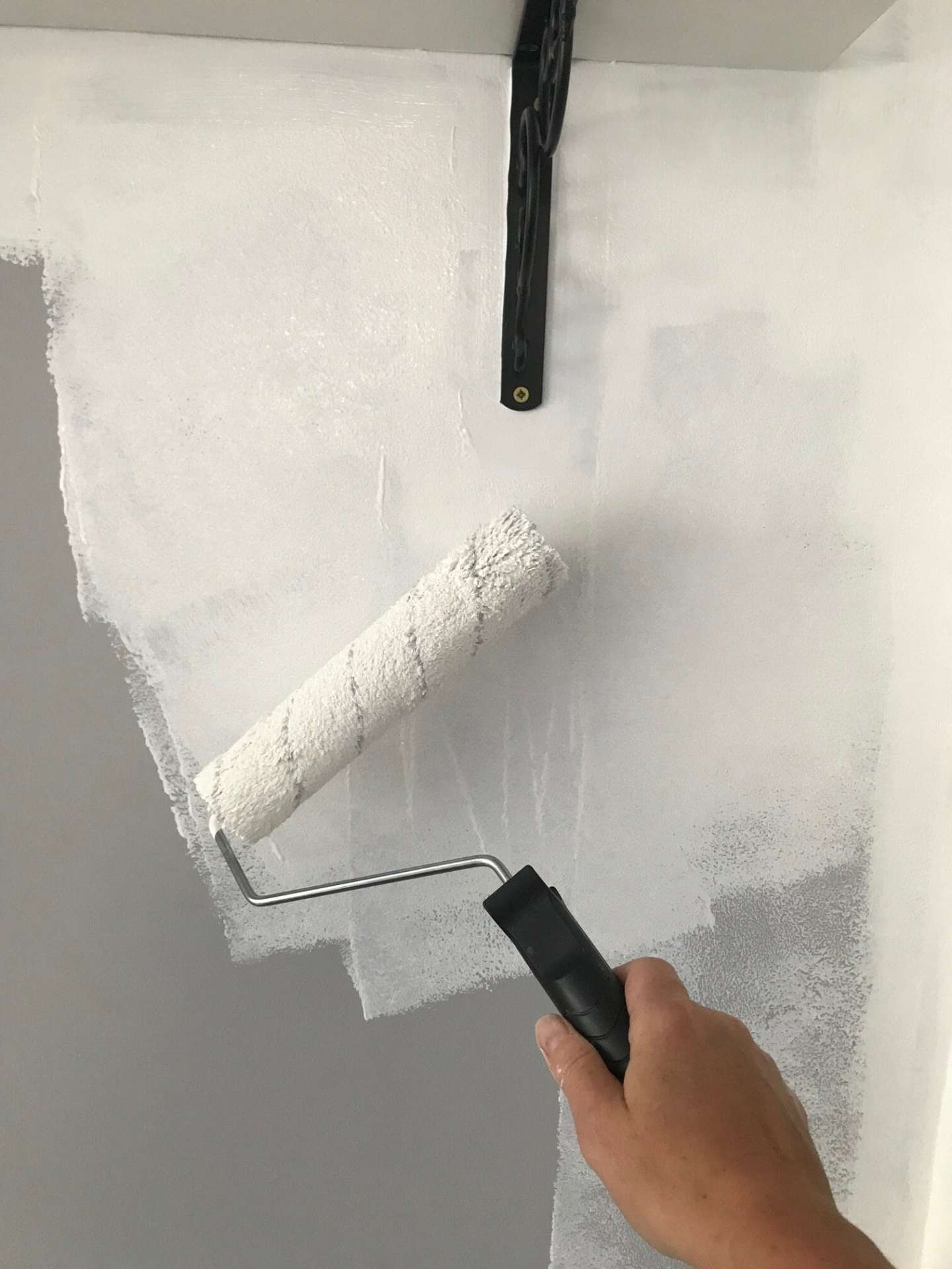 Use a roller brush for quick and even paint cover