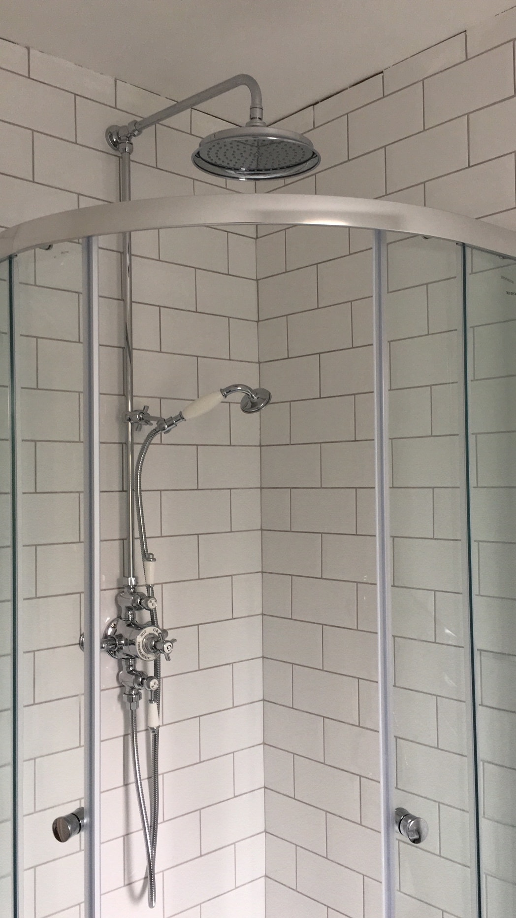 The metro tiles and coveted rainfall shower head