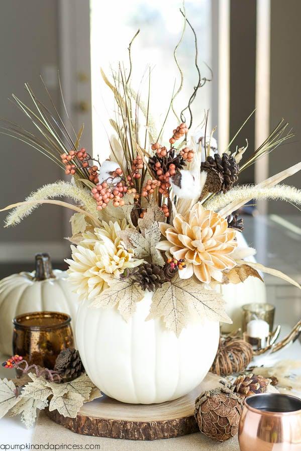 Or for a simpler effect - a pumpkin vase! - www.apumpkinandaprincess.com