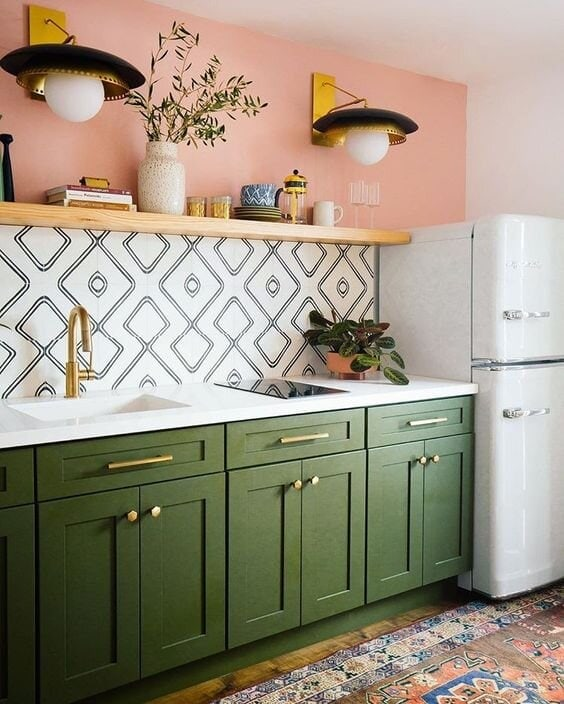 Try adding a hint of pink in the kitchen like this salmon pink above the splashback Credit: @dabito