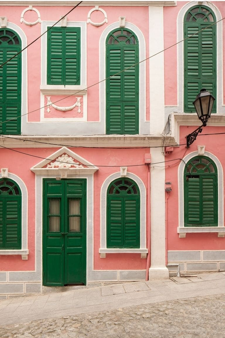 If you want to be really daring, paint your house pink and your doors and shutters green! Credit: townandcountrymag.com