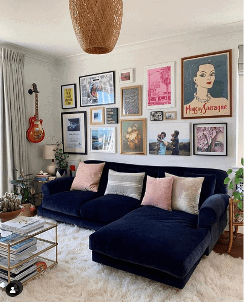 Lisa has used the line of the top of her gorgeous sofa and built the gallery wall from there Instagram: @_lisa_dawson_